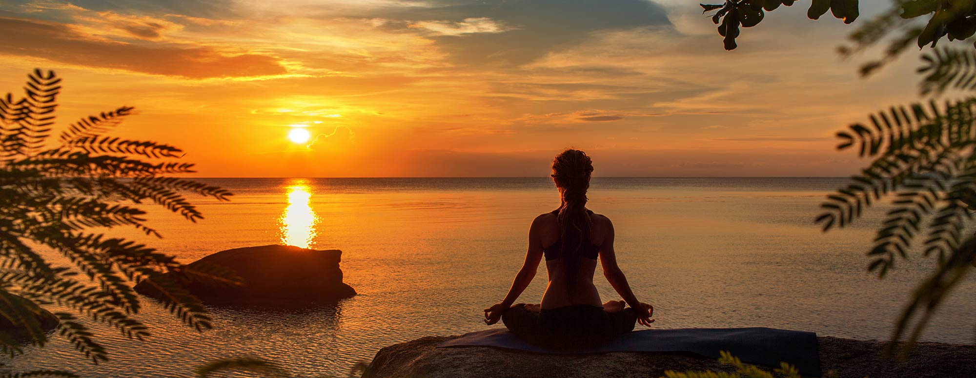 Woman Doing Yoga by Sunset